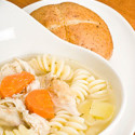 hearty healthy bread with a bowl of chicken soup